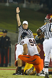 September 11, 2010; Los Angeles, CA, USA;  Virginia Cavaliers defensive end Matt Conrath (94) sacks Southern California Trojans quarterback Matt Barkley (7) during the first quarter at the Los Angeles Memorial Coliseum.