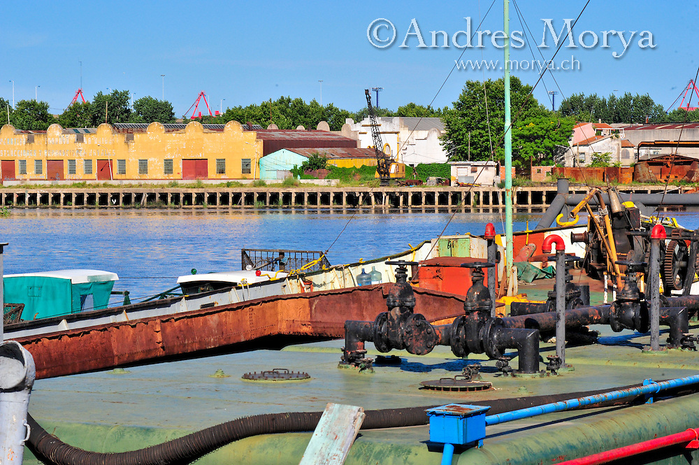 Waterfront scene and Boats docked at La Boca port , Buenos Aires Image by Andres Morya