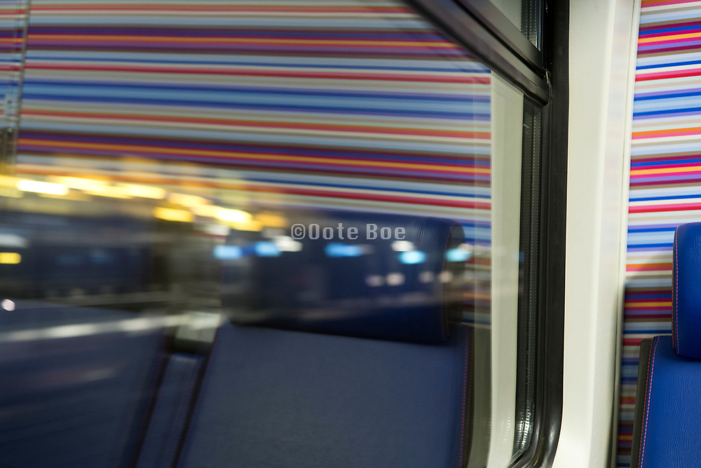 passenger seats in a riding train during night time Netherlands