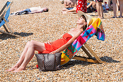 © Licensed to London News Pictures. 07/07/2016. Brighton, UK. Members of the public take the beach in Brighton and Hove as sunny and hot weather continues to hit the seaside resort. (verbal permission granted) Photo credit: Hugo Michiels/LNP