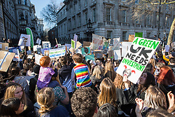 London, UK. 15th February, 2019. Students block Whitehall outside Downing Street during the YouthStrike4Climate for Climate Day which was attended by thousands of young people. Strike events involving schools all over the UK were organised by UK Student Climate Network and the UK Youth Climate Coalition to demand that the Government declare a climate emergency and take positive steps to address the climate crisis, including highlighting the issue as part of the school curriculum, as well as lowering the voting age to 16.