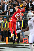 Kansas City Chiefs tight end Travis Kelce (87) leaps in the air and catches a 10 yard touchdown pass good for a 10-7 first quarter Chiefs lead during the 2017 NFL week 7 regular season football game against the against the Oakland Raiders, Thursday, Oct. 19, 2017 in Oakland, Calif. The Raiders won the game 31-30. (©Paul Anthony Spinelli)