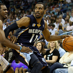 April 1, 2011; New Orleans, LA, USA; Memphis Grizzlies point guard Mike Conley (11) is guarded by New Orleans Hornets point guard Chris Paul (3) during the second quarter at the New Orleans Arena.    Mandatory Credit: Derick E. Hingle