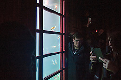 "© Licensed to London News Pictures. 15/01/2016. London, UK.  Hundreds crowd around a red telephone box filled with goldfish which forms ""Aquarium"" by Benedetto Bufalino & Benoit Deselle in Grosvenor Square.  The work forms part of Lumiere London, a major new light festival which is into the second of four evenings and featuring artists who work with light.  The event is produced by Artichoke and supported by the Mayor of London.  Photo credit : Stephen Chung/LNP"