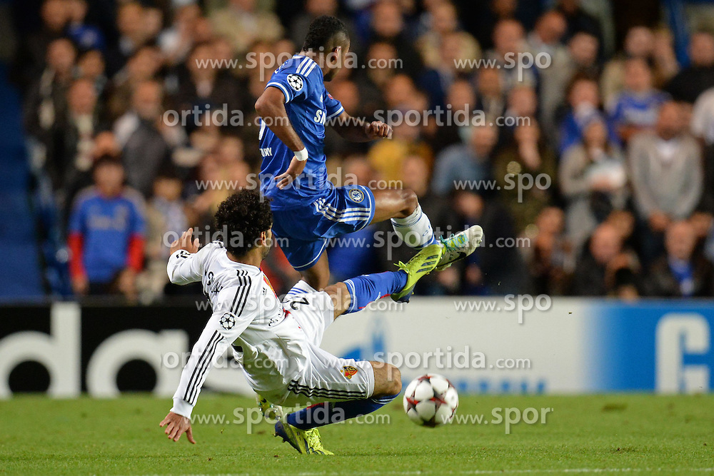 18.09.2013, Stamford Bridge, London, ENG, UEFA Champions League, FC Chelsea vs FC Basel, Gruppe E, im Bild Basel's Mohamed Salah fouls Chelsea's Ashley Cole   during UEFA Champions League group E match between FC Chelsea and FC Basel at the Stamford Bridge, London, United Kingdom on 2013/09/18. EXPA Pictures © 2013, PhotoCredit: EXPA/ Mitchell Gunn <br /> <br /> ***** ATTENTION - OUT OF GBR *****
