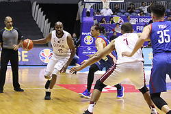 September 17, 2018 - Quezon City, NCR, Philippines - Suliman Abdi Khalid (22, White)of Qatar looks to pass the ball to team mate Mohamed Hassan A Mohamed (1, White) over defender Marcio Lassiter (Blue) of the Philippines. (Credit Image: © Dennis Jerome S. Acosta/Pacific Press via ZUMA Wire)
