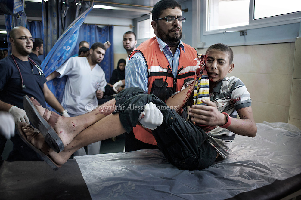 Gaza Strip, Gaza City: A Palestinian boy injured by Israeli shelling is examined at Al Shifa hospital in Gaza City. ALESSIO ROMENZI