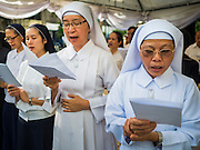21 AUGUST 2015 - BANGKOK, THAILAND:  Thai Catholic nuns participate in the Christian prayer service at Central World to honor the dead from the Erawan Shrine bombing. The Bangkok Metropolitan Administration (BMA) held a religious ceremony Friday for the Ratchaprasong bomb victims. The ceremony started with a Brahmin blessing at Erawan Shrine, which was the target of a bombing Monday night. After the blessing people went across the street to the plaza in front of Central World mall for an interfaith religious service. Theravada Buddhists, Mahayana Buddhists, Muslims, Sikhs, Hindus, and Christians participated in the service. Life at the shrine, one of the busiest in Bangkok, is returning to normal. Friday the dancers and musicians who perform at the shrine resumed their schedules.      PHOTO BY JACK KURTZ
