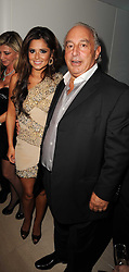CHERYL COLE and SIR PHILIP GREEN at the launch party for 'Promise', a new capsule ring collection created by Cheryl Cole and de Grisogono held at Nobu, Park Lane, London on 29th September 2010.