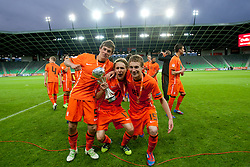 Joris Voest of Netherlands, Wouter Marinus of Netherlands and Pascal Huser of Netherlands celebrate during trophy ceremony after winning the UEFA European Under-17 Championship Final match between Germany and Netherlands on May 16, 2012 in SRC Stozice, Ljubljana, Slovenia. Netherlands defeated Germany after penalty shots and became European Under-17 Champion 2012. (Photo by Urban Urbanc / Sportida.com)