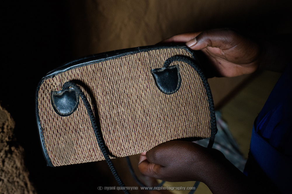 "Florence Amoit keeps her Afripads in a handbag hanging on the wall at her home near Tororo in Eastern Uganda. A student at Aputiri Primary School, which participates in a Menstrual Hygiene Management program supported by Plan International, Florence says she has been using Afripads for about a year, and says they are better than cotton wool because they don't leak. ""I used not to go to school because the blood would come out. But I'm now OK."""
