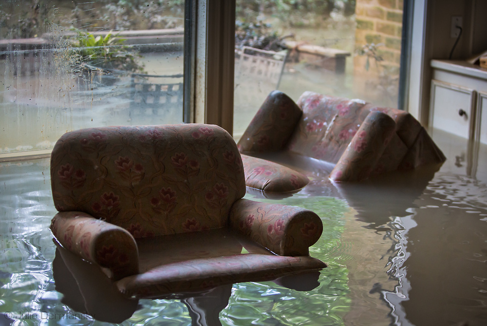Days after Hurricane Harvey first made landfall in Texas, flooded living room in a home in the Woodlands ll subdivision off Gessner  Road and Bayou Shadows, in Houston, Texas remained underwater. The flooding in this part of Houton was impacted by Harvey's rainstomr and  water released from the  Addicks Dam.  When the Addicks Reservoir started to over flow the U.S. Army Corps of Engineers began releasing water from the Addicks Dam, which had already started to overflow.