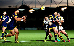 Wynand Olivier of Worcester Warriors offloads the ball to Alafoti Faosiliva of Worcester Warriors - Mandatory by-line: Robbie Stephenson/JMP - 04/12/2016 - RUGBY - Sixways Stadium - Worcester, England - Worcester Warriors v Wasps - Aviva Premiership