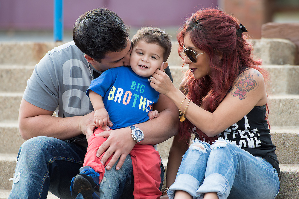 """EAST HANOVER, NJ - APRIL 03:  (EXCLUSIVE COVERAGE, SPECIAL RATES APPLY) Nicole """"Snooki"""" Polizzi and her fiance Jionni LaValle, pictured with their son Lorenzo LaValle on April 3, 2014 in New Jersey, are expecting their second child.  (Photo by Dave Kotinsky/NEP/Getty Images)"""
