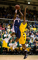 January 30, 2010; San Francisco, CA,  Gonzaga Bulldogs guard Demetri Goodson (3) shoots past San Francisco Dons guard Dontae Bryant (11) during the first half at the War Memorial Gym.   San Francisco defeated Gonzaga 81-77 in overtime.