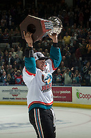 KELOWNA, CANADA - MAY 13: Madison Bowey #4 of Kelowna Rockets skates with the WHL championship trophy on May 13, 2015 during game 4 of the WHL final series at Prospera Place in Kelowna, British Columbia, Canada.  (Photo by Marissa Baecker/Shoot the Breeze)  *** Local Caption *** Madison Bowey;
