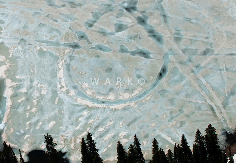 Frozen but thawing lake in Gunnison National Forest, Colorado. May 2014. 84329