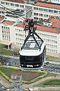 Sugarloaf Cable Car transporting tourists between Praia Vermelha and Sugarloaf Mountain in Rio de Janeiro, Brazil.
