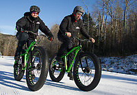 """Sonya Misiaszek gets in a """"lunch hour"""" workout with Kale Poland on their fat bikes at Gunstock Nordic on Thursday afternoon.  (Karen Bobotas/for the Laconia Daily Sun)"""