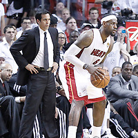 21 June 2012: Miami Heat head coach Erik Spoelstra watches Miami Heat small forward LeBron James (6) during the Miami Heat 121-106 victory over the Oklahoma City Thunder, in Game 5 of the 2012 NBA Finals, at the AmericanAirlinesArena, Miami, Florida, USA. The Miami Heat wins the series 4-1.