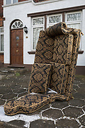 A sofa stands upright in front of a house and awaits collection  in Herne Hill, on 27th February 2018, in London, England.
