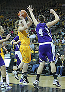 December 30, 2011: Iowa Hawkeyes guard Samantha Logic (22) puts up a shot as Northwestern Wildcats forward Kendall Hackney (4) defends during the NCAA women's basketball game between the Northwestern Wildcats and the Iowa Hawkeyes at Carver-Hawkeye Arena in Iowa City, Iowa on Wednesday, December 30, 2011.