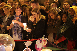 © Licensed to London News Pictures . 29/05/2017 . Manchester , UK .  A vigil is held at 10:31pm in St Ann's Square in Manchester City Centre , exactly a week after Salman Abedi murdered 22 and injured another 64 at an Ariana Grande concert at Manchester Arena . Photo credit: Joel Goodman/LNP