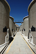 Large storage containers for part of the Pisco-making process. This is in the Pisco Mistral distillery in the village of Pisco Elqui in Chile's Coquimbo region, near La Serena