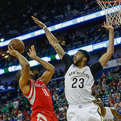 Mar 17, 2017; New Orleans, LA, USA; Houston Rockets guard Eric Gordon (10) shoots over New Orleans Pelicans forward Anthony Davis (23) during the first quarter of a game at the Smoothie King Center. Mandatory Credit: Derick E. Hingle-USA TODAY Sports