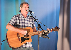 Pictured: Hooseband lead singer Gordon McKay <br /> <br /> The community in Portobello came out last night in support of a locally organised campaign to try and save a local church and its attached church hall for the community. No longer needed by the church, who plan to sell it, the hall is widely used by community groups. The campaign hopes to make use of Scottish community buy-out legislation that has recently been extended to cover urban areas in one fo the first such campaigns in a Scottish urban area. Local film acting couple, Shauna Macdonald and Cal MacAninch, were instrumental in the event that featured a variety of local talent and was attended by about 150 people, packing out the church hall. Shauna brought the show together, along with her sister Kyrsta, and Cal performed on stage in both the specially written short play that opened the evening and singing with the band Hooseband at the show's finale.  <br /> <br /> © Jon Davey/ EEm