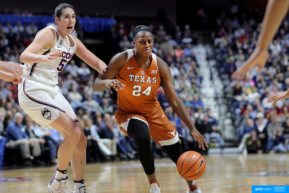 UNCASVILLE, CONNECTICUT- DECEMBER 4: Joyner Holmes #24 of the Texas Longhorns in action while defended by Natalie Butler #51 of the Connecticut Huskies  during the UConn Huskies Vs Texas Longhorns, NCAA Women's Basketball game in the Jimmy V Classic on December 4th, 2016 at the Mohegan Sun Arena, Uncasville, Connecticut. (Photo by Tim Clayton/Corbis via Getty Images)