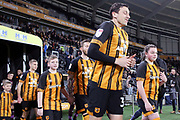 Hull City defender Tommy Elphick (35) takes to the field of play before  the EFL Sky Bet Championship match between Hull City and Swansea City at the KCOM Stadium, Kingston upon Hull, England on 22 December 2018.