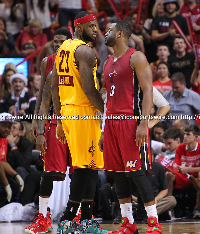 Dec. 25, 2014 - Miami, FL, USA - Cleveland Cavaliers forward LeBron James (23) and Miami Heat guard Dwyane Wade (3) pass each other during the fourth quarter of an NBA basketball game on Dec. 25, 2014 at the AmericanAirlines Arena in Miami. The Heat won 101-91