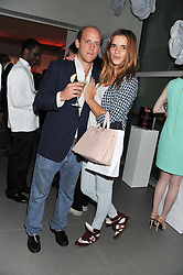 CARLO CARELLO and PHOEBE WATSON at a party hosted by Ines de la Frssange and Bruno Frisoni for Roger Vivier to launch the Roger Vivier book held at The Saatchi Gallery, London on 24th April 2013.