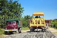 Truck and bulldozer near Manuel Lazo, Pinar del Rio, Cuba.