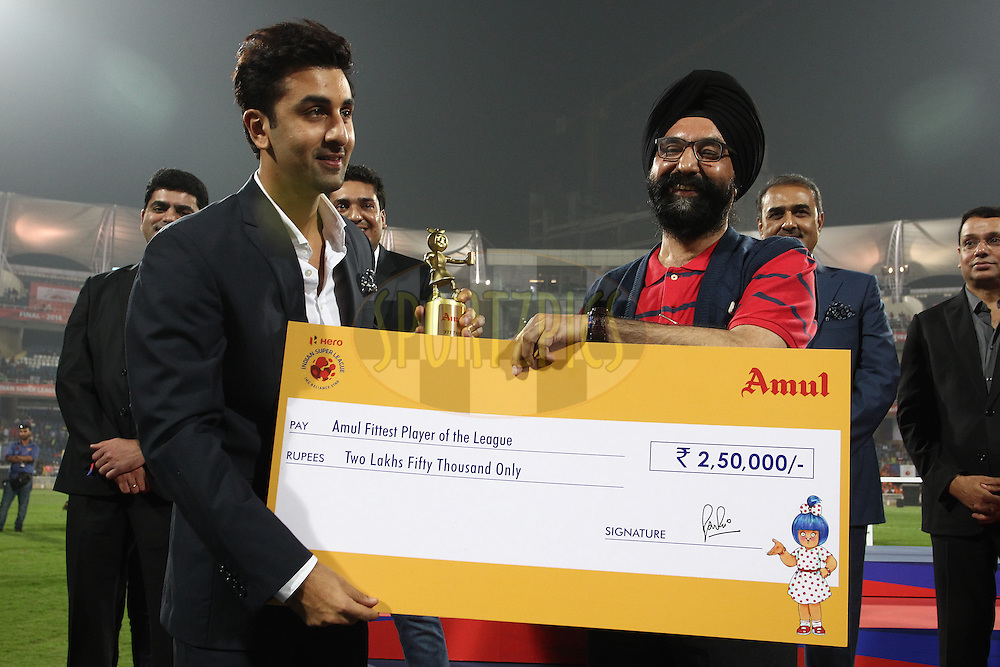 Ranbir Kapoor Co-Owner of Mumbai City FC receives the Amul Fittest Player of the League Award for Jan Stohanzl of Mumbai City FC from Mr RS Sodhi of Amul during the final of the Hero Indian Super League between Kerala Blasters FC and Atletico de Kolkata held at the D.Y. Patil Stadium, Navi Mumbai, India on the 2oth December 2014.<br /> <br /> Photo by:  Shaun Roy / ISL/ SPORTZPICS