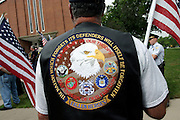 Detail of the leather jacket worn by a member of the Patriot Guard Riders during the funeral service of Sgt. Ian T. Sanchez, in Staten Island, NY., on Tuesday, June 27, 2006. Sgt. Sanchez, a 26-year-old American serviceman was killed by a roadside bomb in the Pech River Valley, Afghanistan. The Patriot Guard Riders is a diverse amalgamation of riders from across the United States of America. Besides a passion for motorcycling, they all have in common an unwavering respect for those who risk their lives for the country's freedom and security. They are an American patriotic group, mainly but not only, composed by veterans from all over the United States. They work in unison, calling upon tens of different motorcycle groups, connected by an internet-based web where each of them can find out where and when a 'Mission' is called upon, and have the chance to take part. This way, the Patriot Guard Riders can cover the whole of the United States without having to ride from town to town but, by organising into different State Groups, each with its own State Captain, they are still able to maintain strictly firm guidelines, and to honour the same basic principles that moves the group from the its inception. The main aim of the Patriot Guard Riders is to attend the funeral services of fallen American servicemen, defined as 'Heroes' by the group,  as invited guests of the family. These so-called 'Missions' they undertake have two basic objectives in particular: to show their sincere respect for the US 'Fallen Heroes', their families, and their communities, and to shield the mourners from interruptions created by any group of protestors. Additionally the Patriot Guard Riders provide support to the veteran community and their families, in collaboration with the other veteran service organizations already working in the field.   **ITALY OUT**