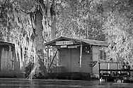 Fishing camp on the the Pearl River in St. Tammany Parish, Louisiana, lined with Cypress and Tupelo trees.