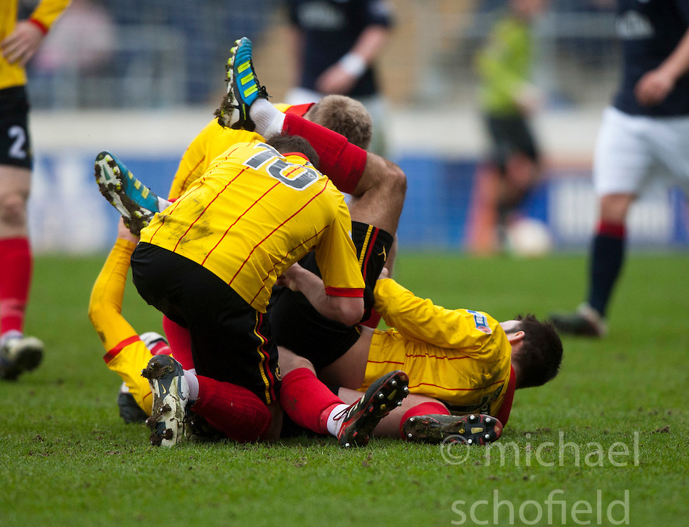 Partick Thistle's Paul Cairney (hidden) celebrates after scoring their goal..half time, Falkirk v Partick Thistle, 10/3/2012..©Michael Schofield.