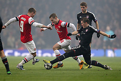 19.02.2013, Emirates Stadion, London, ENG, UEFA Champions League, FC Arsenal vs FC Bayern Muenchen, Achtelfinale Hinspiel, im Bild Lukas PODOLSKI (FC Arsenal London - 9) und Jack WILSHERE (FC Arsenal London - 10) im Zweikampf mit Bastian SCHWEINSTEIGER (FC Bayern Muenchen - 31) // during the UEFA Champions League last sixteen first leg match between Arsenal FC and FC Bayern Munich at the Emirates Stadium, London, Great Britain on 2013/02/19. EXPA Pictures © 2013, PhotoCredit: EXPA/ Eibner/ Ben Majerus..***** ATTENTION - OUT OF GER *****