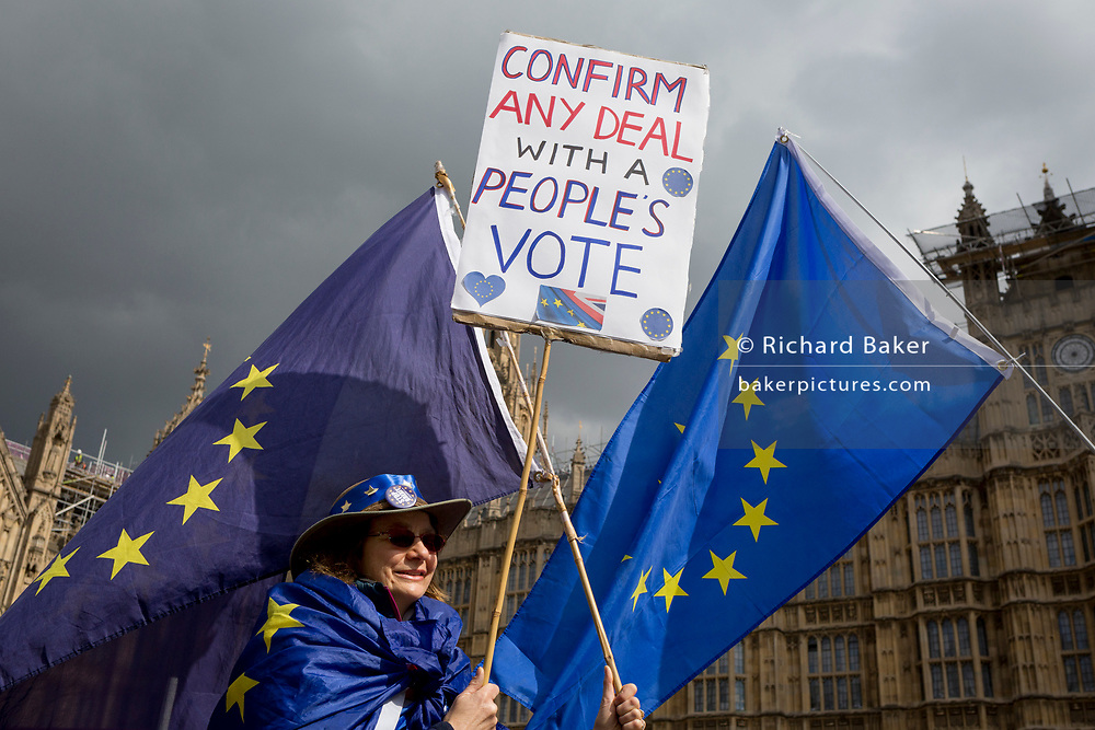 On the day that Prime Minister Theresa May meets with Labour leader Jeremy Corbyn in an attempt to break the Brexit deadlock in parliament, a pro-EU protestor holds a placard and an EU flag opposite Parliament in Westminster, on 3rd April 2019, in London, England.