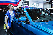 New York, NY - 1 April 2015. A man polishes a new BMW at the New York International Auto Show.