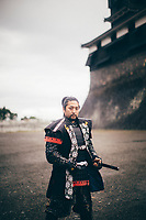 A Japanese man dressed as a samurai at Kumamoto Castle on the island of Kyushu, Japan.
