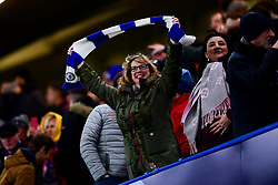 A Chelsea fan waves a scarf prior to kick off - Mandatory by-line: Ryan Hiscott/JMP - 10/12/2019 - FOOTBALL - Stamford Bridge - London, England - Chelsea v Lille - UEFA Champions League group stage