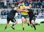 Australia full-back Jack Maddocks breaks through between New Zealand second-row Quinten Strange and  prop Ayden Johnstone during the World Rugby U20 Championship 5rd Place play-off  match Australia U20 -V- New Zealand U20 at The AJ Bell Stadium, Salford, Greater Manchester, England on Saturday, June  25  2016.(Steve Flynn/Image of Sport)
