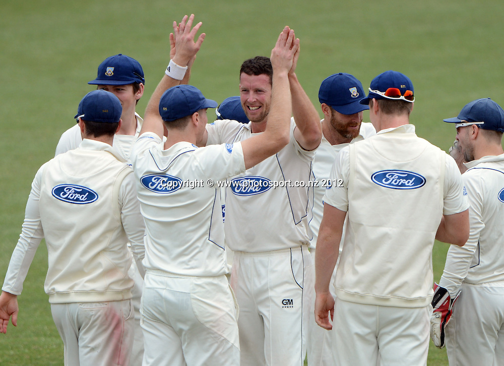 Otago's Ian Butler celebrates the wicket of Kyle Mills. Plunket Shield Cricket, Auckland Aces v Otago Volts at Eden Park Outer Oval. Auckland on Tuesday 4 December 2012. Photo: Andrew Cornaga/Photosport.co.nz