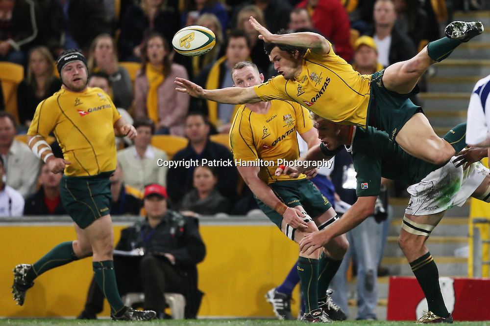 Adam Ashley Cooper gets airbourne during the Tri-Nations rugby Test at Suncorp Stadium in Brisbane,  July 24, 2010. The Wallabies defeated the world champion Springboks to win the first Tri-nations rugby Test 30-13. Photo: Patrick Hamilton/Photosport