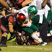 22 September 2018: San Diego State Aztecs cornerback Tayler Hawkins (32) safety Parker Baldwin (33) bring down Eastern Michigan Eagles running back Ian Eriksen (25) after a short gain in the second quarter. The San Diego State Aztecs beat the Eastern Michigan Eagles 23-20 in over time at SDCCU Stadium in San Diego, California.