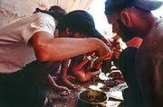 people eating in shade, Middle East Tek, Wadi Rum, Jordan, 2008