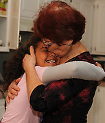 SUN-STAR PHOTO BY BEA AHBECK<br /> Renate embraces her granddaughter Jasmine, who is thanking her grandmother for her Christmas presents on Christmas eve Dec. 24, 2010.